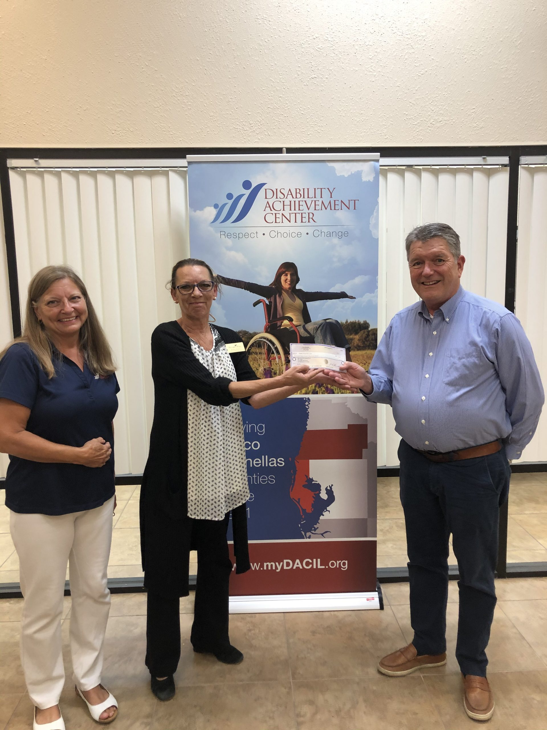 Kathleen presents Board President with donationeck as Jody Armstrong looks on