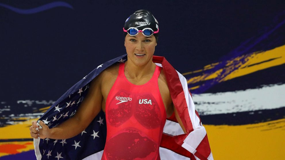 Becca Meyere in red swimsuit draped with American flag